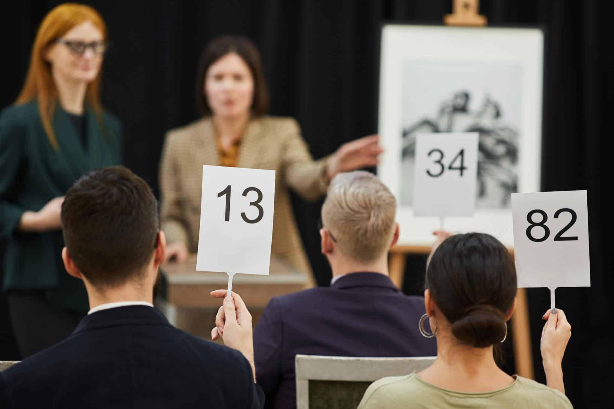 Do Incentivized Fundraising Auctions Raise More Money? How?